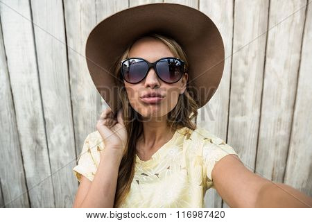 Young female with glasses taking selfie