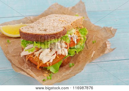 Sandwich With Chicken On A Wooden Background