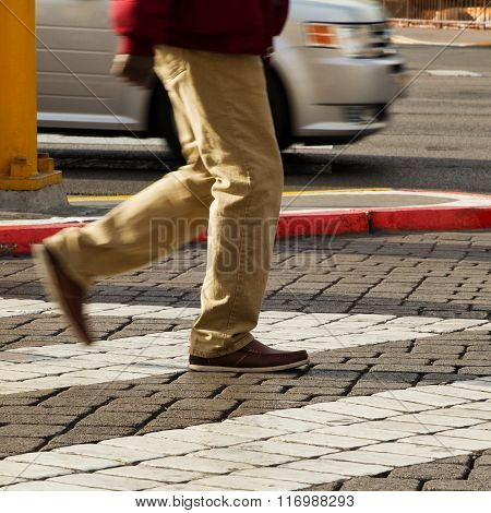 Cropped Image Of Man Crossing The Road
