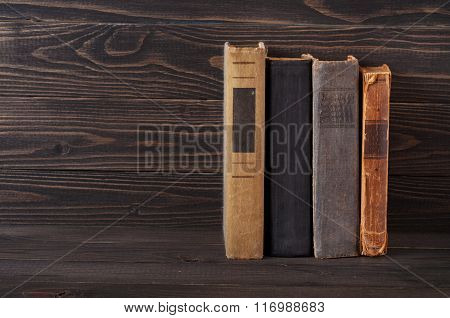 Group Of Old Hardcover Books On A Dark Wooden Background