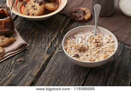Tasty Oatmeal Porridge With Bananas In White Bowl