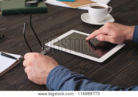 Man Working With A Tablet Computer For The Office Desk