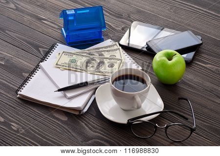 Stack Of Notebook With A Cup Of Coffee, Money, House
