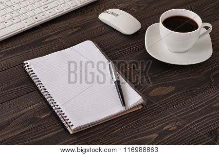 Notebook With Blank Pages And A Cup Of Black Coffee