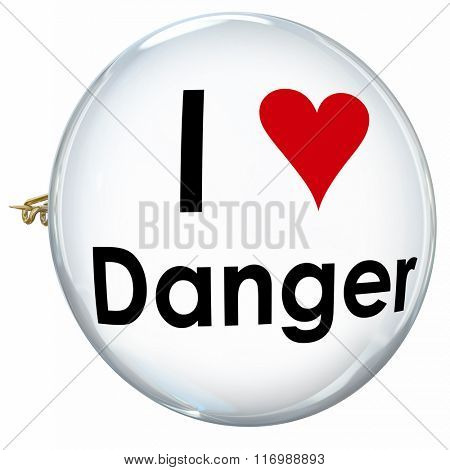 I Love Danger words and heart on a pin or button to illustrate someone who is reckless, foolish, a daredevil or thrill seeker and wants constant adventure in life
