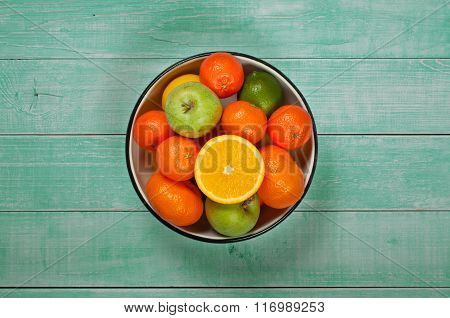 Fresh Fruit In A Bowl On A Light Wooden Background