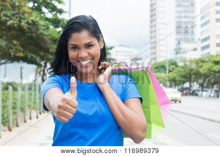 Native Latin Woman With Blue Shirt After Shopping In City