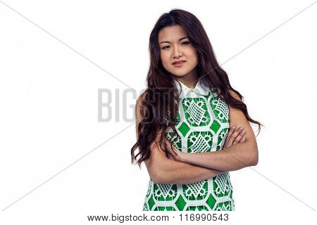 Asian woman with arms crossed smiling on white screen