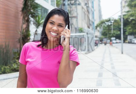 Native American Woman Laughing At Phone In The City