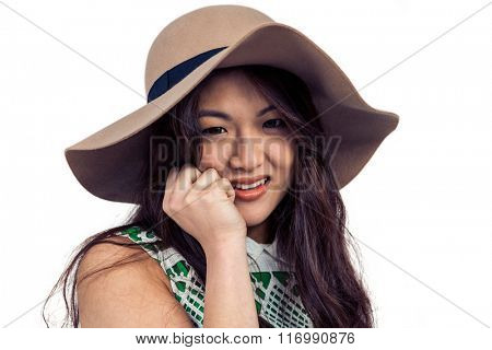Asian woman with hat posing for camera on white screen
