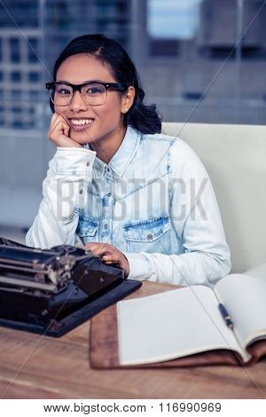 Asian woman typewriting in office