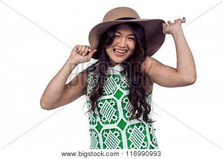 Happy Asian woman wearing hat on white screen