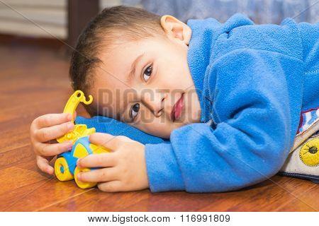 Boy Lying Down Playing
