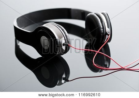black wired headphones on glass table