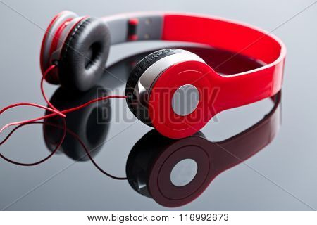 red wired headphones on glass table