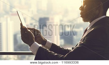 African Businessman Using Digital Tablet Concept