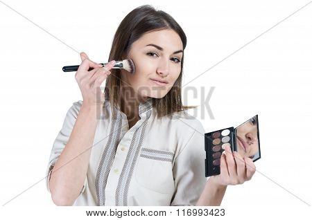 Young Girl Paints Her Cheeks. Girl Doing Makeup