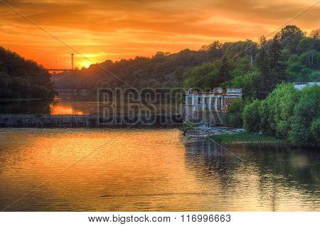 Sundown at river dam
