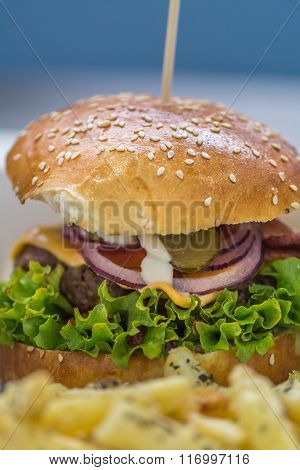 American Hamburger With Fries Detail Background. Big Delicious American Hamburger With Salad, Onion,