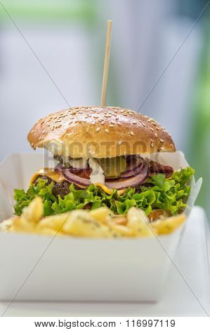 Junk Hamburger Meal With Fries Over Paper Plate. Big Delicious American Junk Hamburger With Salad, O
