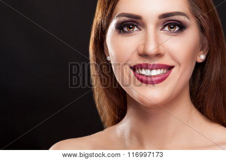 Smiling Woman With Perfect Make Up And Teeth On Black Background