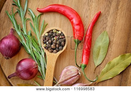 Herbs And Spices On Wooden Board. Chili, Rosemary, Pepper, Bay Leaf, Onion, Garlic