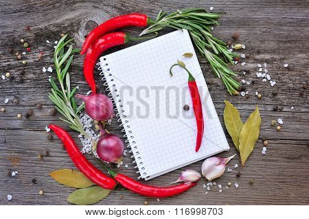 Vegetables And Seasonings With Open Notebook For Recipes On A Wooden Background