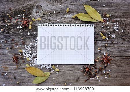 Leaf From A Notebook With Spices On A Wooden Background