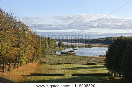 View of a garden park, lake in late evening lit.