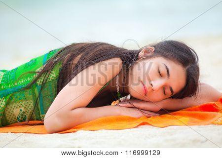 Teen Girl Lying Down On Hawaiian Beach, Resting By Ocean