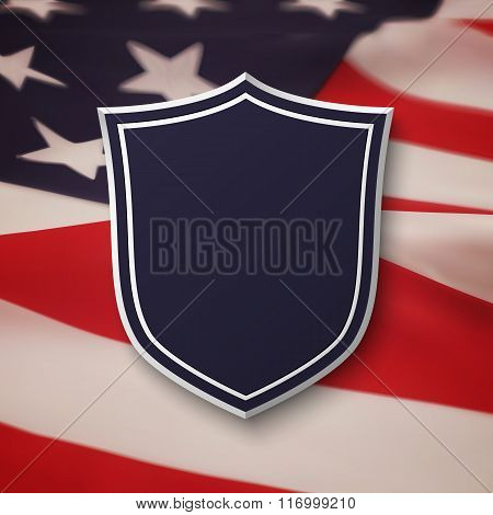 Blank, blue shield on top of American flag.