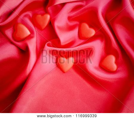Red Hearts On Satin Fabric Background