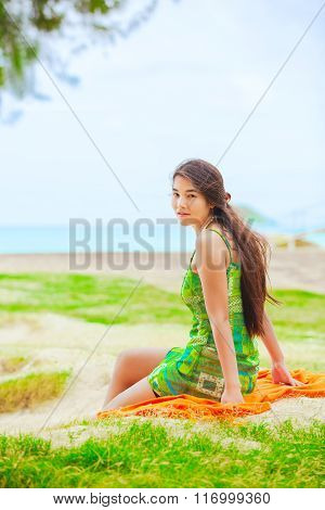 Teen Girl In Green Sundress At Beach Looking Over Shoulder