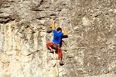 ������, ������: Sportsman climbing on the rock