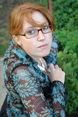 picture of clevage  - a beautiful redhead with glasses and a cute smile - JPG