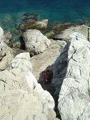 Woman On Rocks