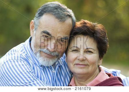 Happy Elderly Couple Embracing Outdoorsstock photosHappy Elderly Couple