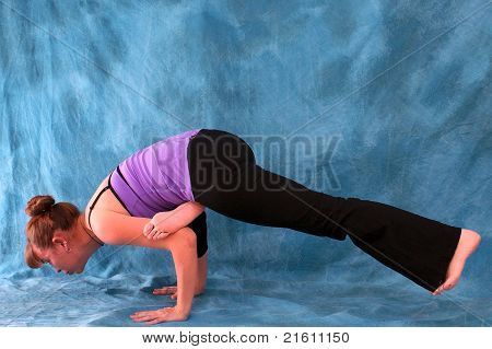 Woman In Flying Crow Yoga Pose