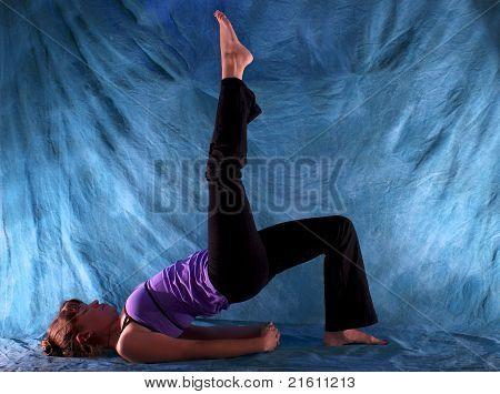 Woman In One Leg Bridge Yoga Pose