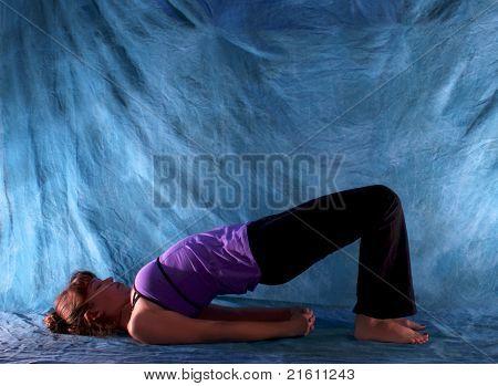 Woman In Yoga Bridge Pose