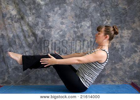 Woman Doing Yoga Posture Navasana Or Boat Pose