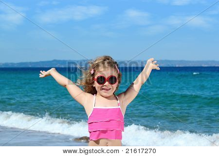 happy little girl with sunglasses