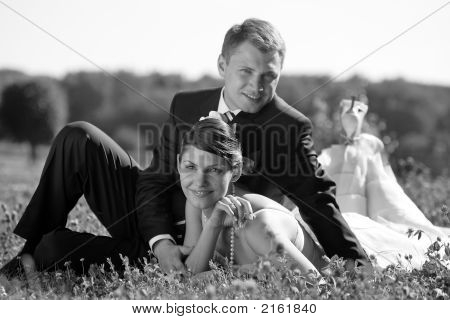 Newly Married Couple Smiling In A Field