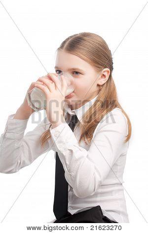 Little Blond Caucasian Girl Drinking Milk