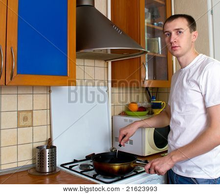 Adult Man Cooking At The Kitchen