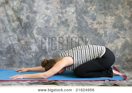 Woman Doing Yoga Posture Balasana Or Childs Pose