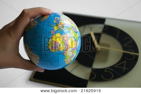 Globe And Watch On Background