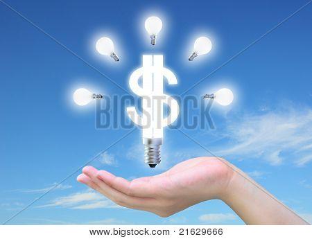 light bulb model of a dollar symbol in women hand on sky