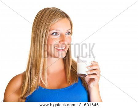Pregnant woman with glass of milk isolated on white