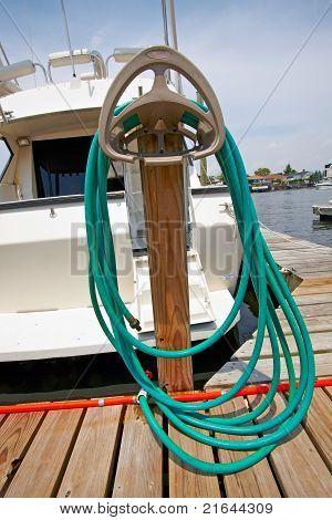 Motor Boat Docked In The Marina.